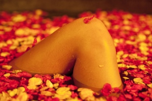 courtesy http://www.gettyimages.com/detail/photo/female-relaxing-in-rose-petal-filled-spa-bath-royalty-free-image/121385647